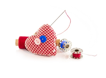 Pincushion with needle, buttons and threads