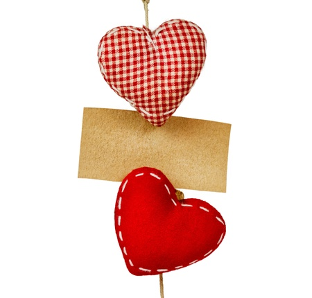 fabric hearts with empty paper on string Stock Photo