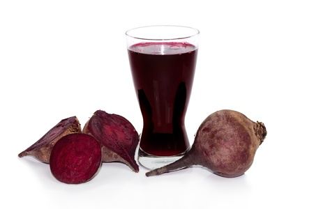 fresh beets with clear juice in tall glass photo