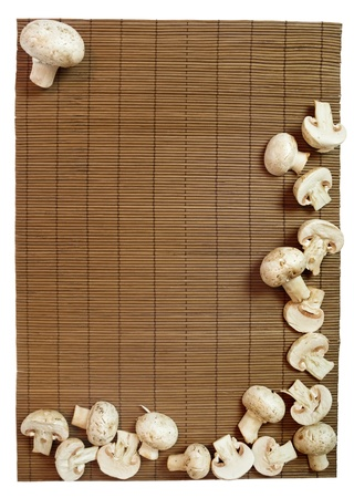 Fresh champignons on wooden background in frame shape  Stock Photo - 17990526