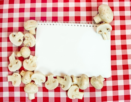 background for cooking recipes, mushrooms around blank paper Stock Photo - 17990525