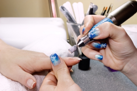 woman having a manicure at nail salon Stock Photo