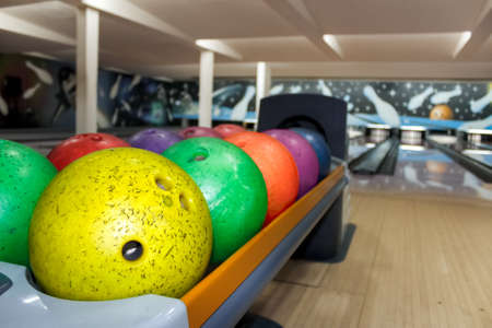 colorful bowling balls in bowling center