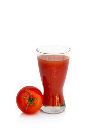 Fresh tomato juice isolated over white background