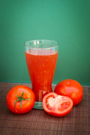 Full glass of fresh tomato juice and tomatoes Stock Photo - 18956931