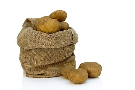 Burlap sack of freshly dug new potatoes on white background Stock Photo - 18956927