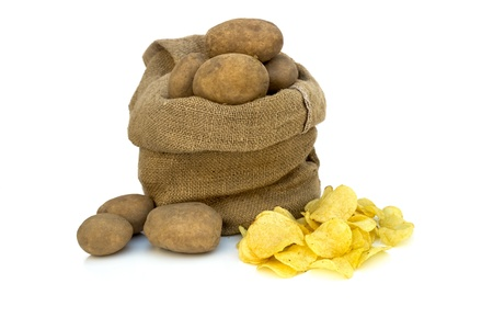 Potato chips with raw potatoes in burlap sack photo