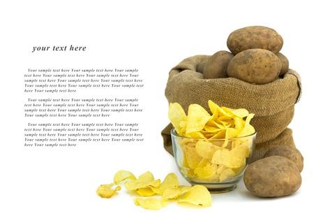 raw potato: Delicious potato chips isolated over white background