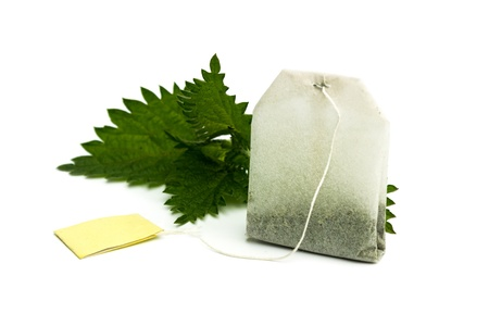 Teabag and fresh nettles leaves