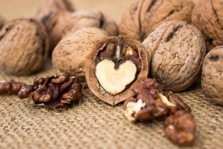 walnut and a cracked walnutover burlap fabric