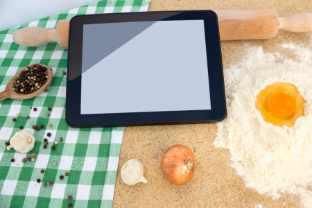 using a digital tablet at modern kitchen