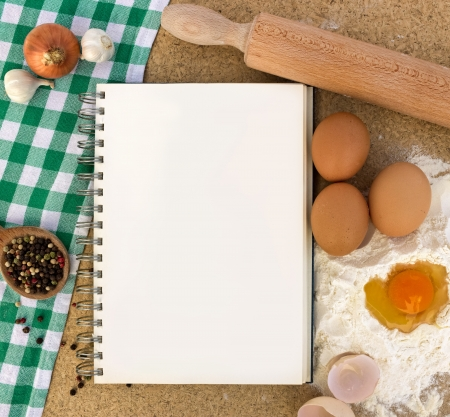 Recipe book with basic ingredients for baking Archivio Fotografico