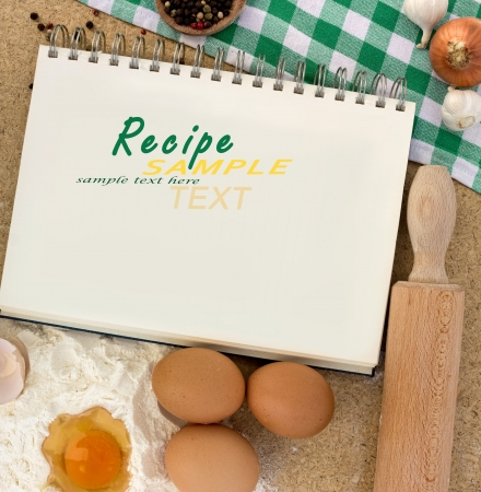 blank notebook for recipes with baking ingredients
