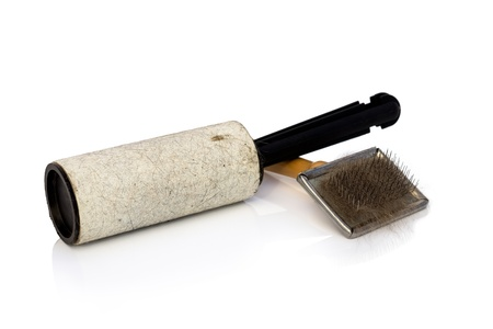 Roller for removing animal hair and hair brushes