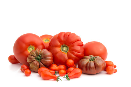 Group of several different tomato kinds, on white background photo