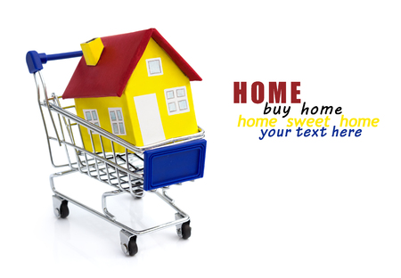 House shopping and buying homes as a real estate market symbol with a shop cart Stock Photo