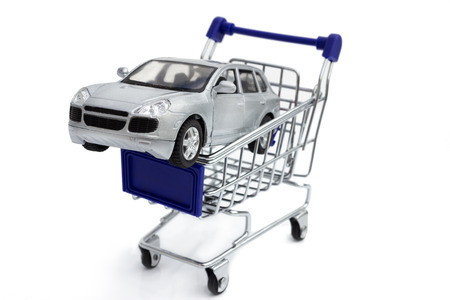 Car shopping, new car in a shopping basket. photo