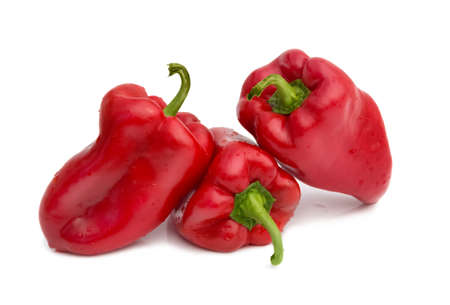 glister: Red peppers over white background