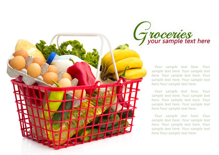 Shopping basket with groceries	, isolated over white background