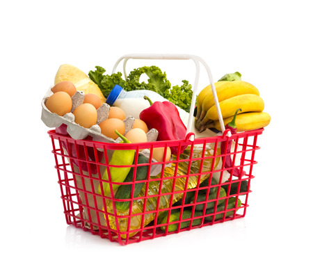 Full shopping basket, isolated over white background  Foto de archivo