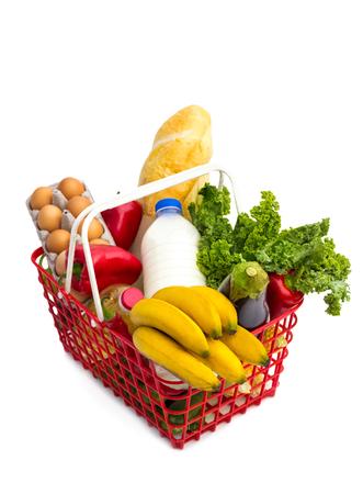shopping basket full of fresh colorful vegetables,  isolated on white background  Stock Photo