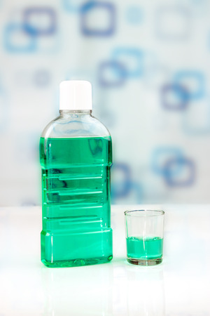 mouthwash: Mouthwash bottle, concept oral hygiene Stock Photo