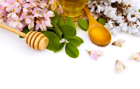 owe: acacia honey in wooden spoon owe white Stock Photo