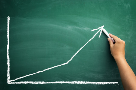 Writing chalk color chart shows an increase in business.