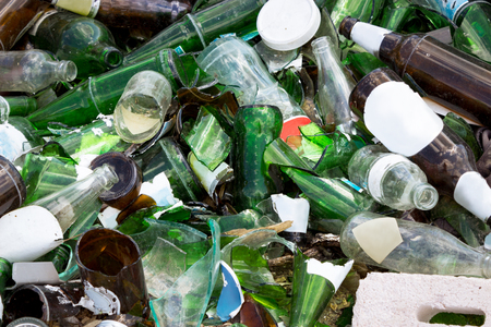 Background of clear and green glass broken on landfills Imagens