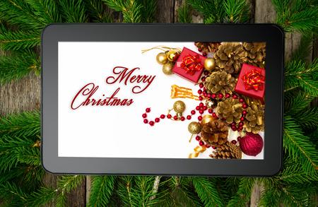 Tableta de Navidad en el �rbol de brunch de Foto de archivo