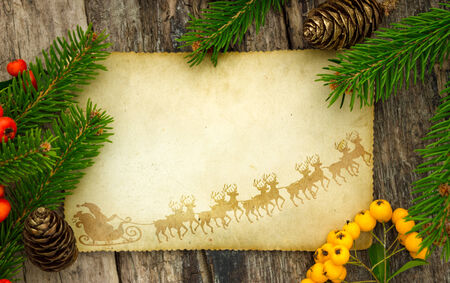 santa sleigh: greeting card  or wish list,  vintage paper with  Christmas decoration around