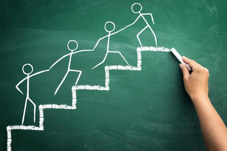 Team work for success, handwriting with chalk on blackboard