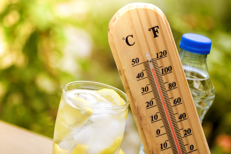 Refresh drink with thermometer, concept   warm weather