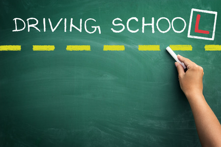 Driving school handwriting on green blackboard Stock Photo