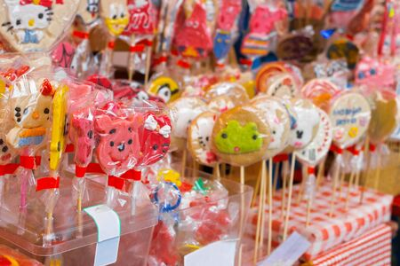 many different color lollipops, background sweets