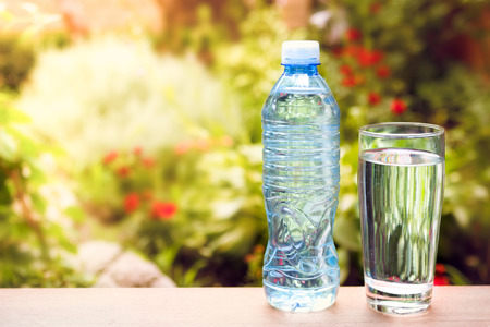 sunstroke: Bottle with fresh water on sunny day, outdoor