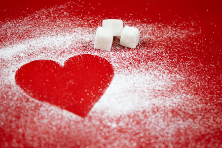 white backing: Heart of white powdered sugar on a red background, Valentines Day,  cooking with love, holiday backing background Stock Photo