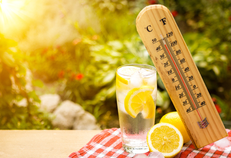 thermometer shows a high temperature during heat wave Stock Photo