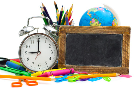 multicolored school items on white background