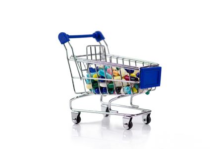 shoppingcart: Pharmacy medicine. Shopping cart with pills and medical supplies