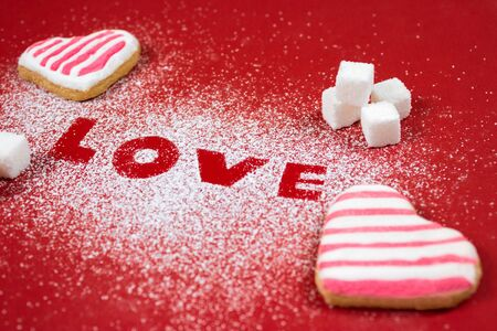 sweet heart: sweet Valentines Day background with heart of icing sugar, heart shaped cookies and sugar cubes