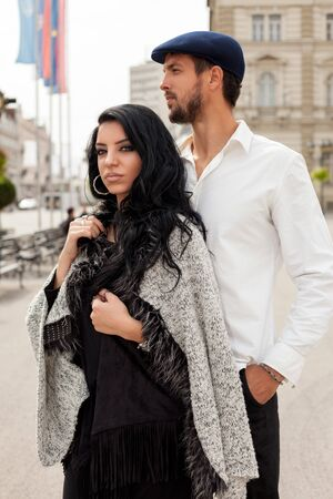 Fashion couple posing together in the city