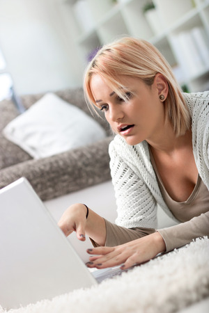smiled: Young girl spending too much time online on her laptop
