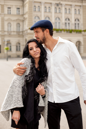 Attractive fashion couple posing hugged on the street Stock Photo