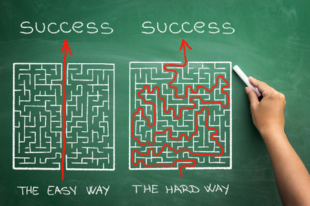 hard and easy way illustrated shown by maze on blackboard