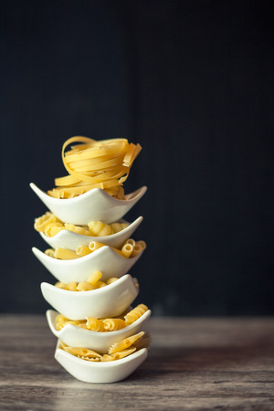 Small shaped pasta standing arranged in white bowls Stock Photo