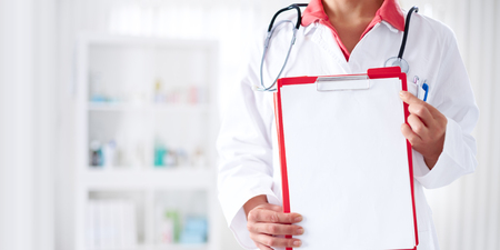 doctoring: Doctor with stethoscope holding clipboard with blank sheet of paper, you can place your text in copy space Stock Photo