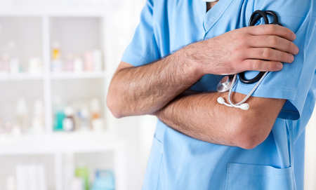 doctoring: Close-up of a doctor in front of a bright background
