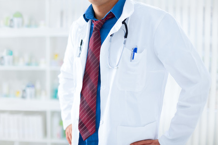doctoring: Male doctor during working hours at the clinic