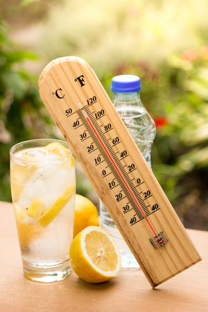 High temperature on a thermometer and water with ice Standard-Bild